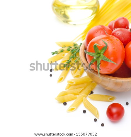 fresh tomatoes, penne pasta, spaghetti and spices isolated on a white background