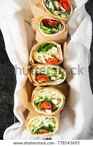 Fresh tortilla wraps with vegetables and chicken. Gourmet conception.