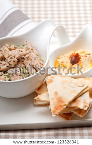 fresh traditional arab chicken taboulii couscous with hummus