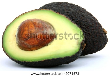 Fresh tropical avocado pear fruit, healthy food on white, macro close up over white with copy space.