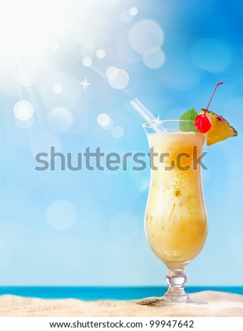 Fresh tropical cocktail on beautiful sunny beach