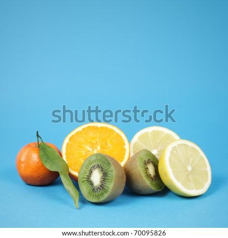 Fresh tropical fruit on blue background