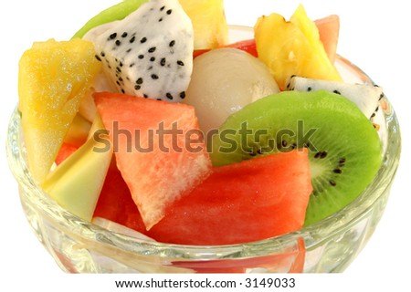 Fresh tropical fruit salad in a glass serving dish