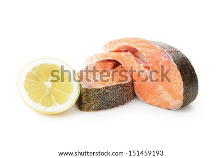 fresh trout steaks with lemon, on white background