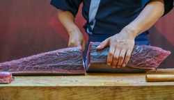 Fresh Tuna fish cut by professional Japanese chef. Tuna can be a good source of omega - 3 fatty acids.