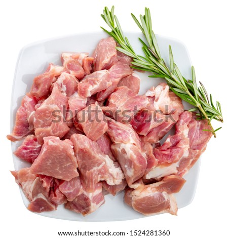 Fresh uncooked chopped pork for stew. Isolated over white background