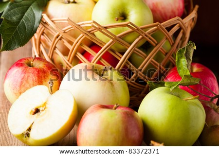 Fresh various apples closeup on wooden table