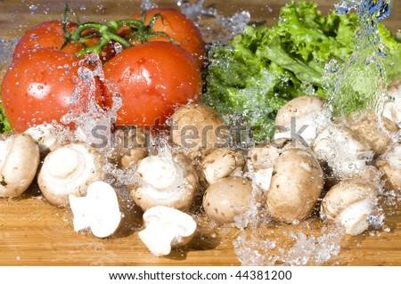 Fresh vegetable and splashing water.Vegetarian food background with water drop