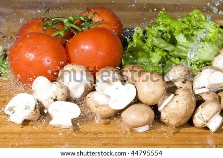 Fresh vegetable and splashing water.Vegetarian food background with water drop - stock photo