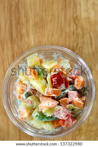 Fresh vegetable salad in a glass