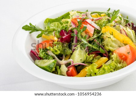 Fresh vegetable salad. On a white background #1056954236