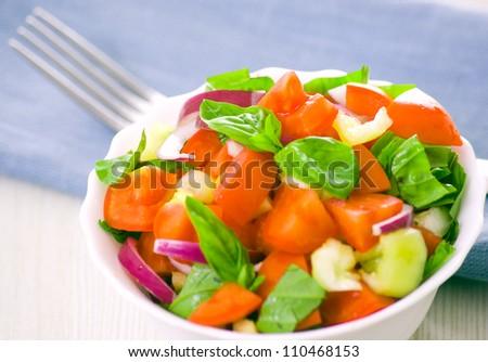 fresh vegetable salad with basil