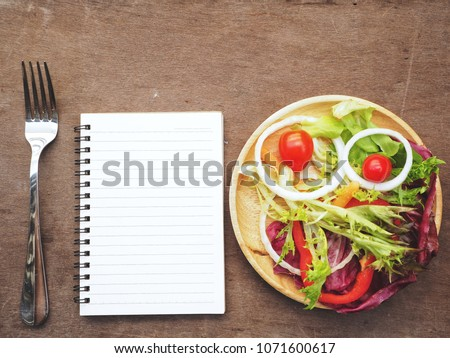 Fresh vegetable salad with blank notepad #1071600617