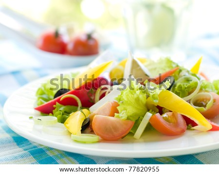 Fresh vegetable salad with cheese. Shallow depth, selective focus
