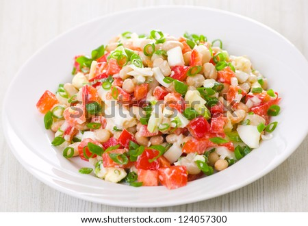 fresh vegetable salad with white beans, red pepper, tomato, egg and green onions