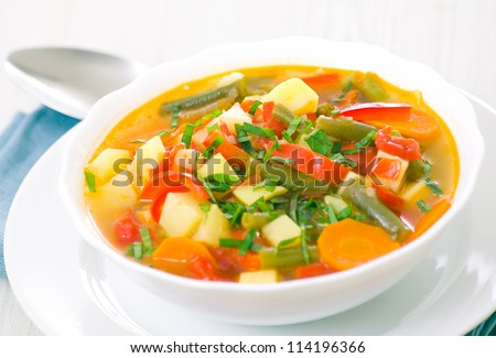 Fresh vegetable soup made of green bean, carrot, potato, red bell pepper, tomato in bowl #114196366