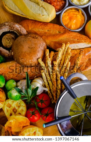 Fresh vegetables and fresh tomato,brussels sprouts, bread, cinnamon rolls, picture placement, still light, shadow #1397067146