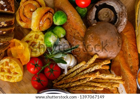 Fresh vegetables and fresh tomato,brussels sprouts, bread, cinnamon rolls, picture placement, still light, shadow #1397067149