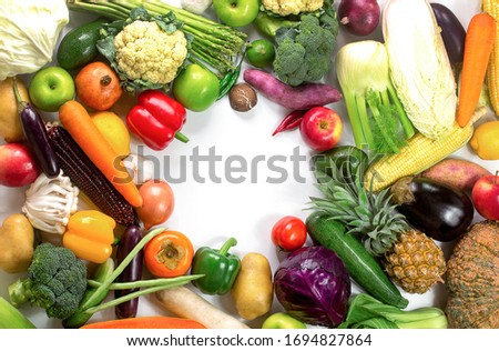 Fresh vegetables and fruits isolated on white background with copy space,Colorful fruits and vegetables,clean eating,vegetables and fruits background,top view,Set of fruits and vegetables,Food concept