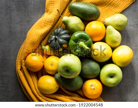 Fresh vegetables and fruits on a table. Yellow and gray textured background. Seasonal organic vegetables from local market. Healthy eating concept.  Foto stock ©