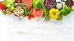 Fresh vegetables and fruits on a white background. Top view. Free copy space.