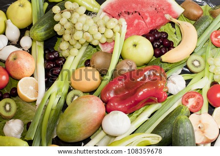 fresh vegetables and fruits on the black cover