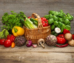 fresh vegetables and herbs on wooden background. raw food ingredients. country style picture