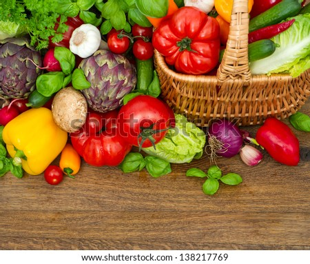 fresh vegetables and herbs on wooden background. raw food. top view