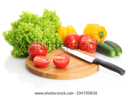 fresh vegetables and knife on cutting board isolated on white