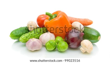 Fresh vegetables and mushrooms on a white background close-up