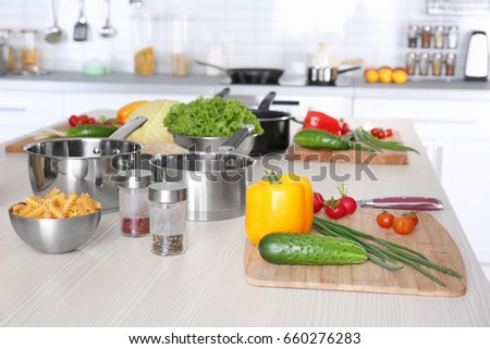 Shutterstock Fresh vegetables and utensils for cooking classes on wooden table