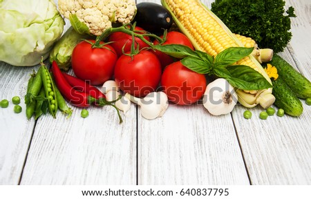fresh vegetables as a frame on a old wooden table #640837795