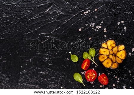 Fresh vegetables. Black background and top view. Copy space. Copy space and horizontal orientation.