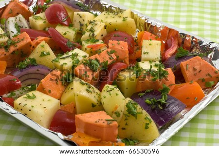 Fresh vegetables cut up and seasoned ready for roasting