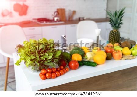 Fresh vegetables for salad on a kitchen table. Concept healthy food background. Vegetarian food.