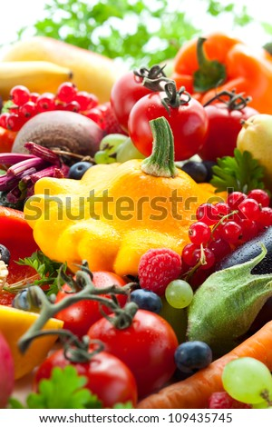 Fresh vegetables,fruits and berries on the white background