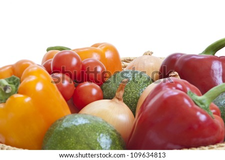Fresh vegetables in a basket on white background