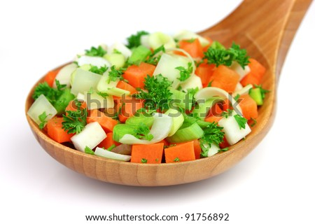 Fresh vegetables in a wooden spoon