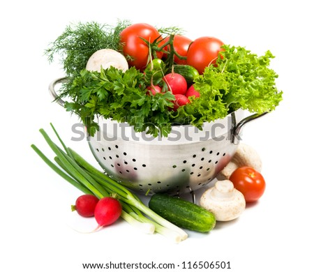 Fresh vegetables in metal bowl on white background - stock photo