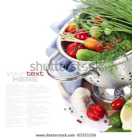 Fresh vegetables in metal colander over white (with sample text) #83355106