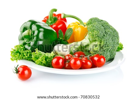 fresh vegetables in plate isolated on white background