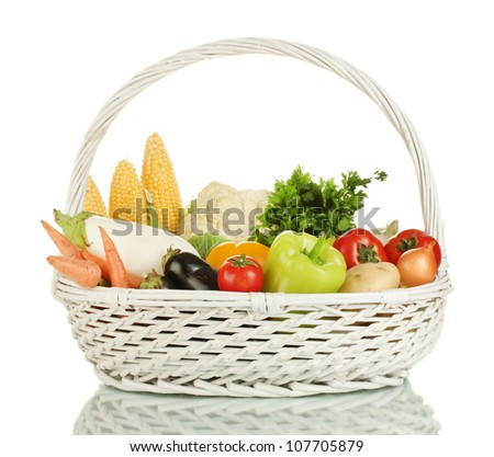 Fresh vegetables in white basket isolated on white