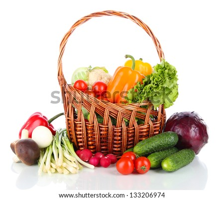 Fresh vegetables in wicker basket  isolated on white