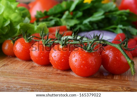 fresh vegetables. Included are tomatoes, cucumber, onions and green leaves