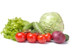 Fresh vegetables including a lettuce tomato cabbage onions onions isolated on white isolated background