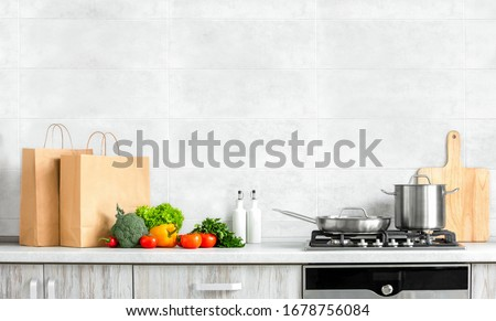 Fresh vegetables just bought in a supermarket and put on a kitchen countertop, ready for cooking, healthy food culinary concept