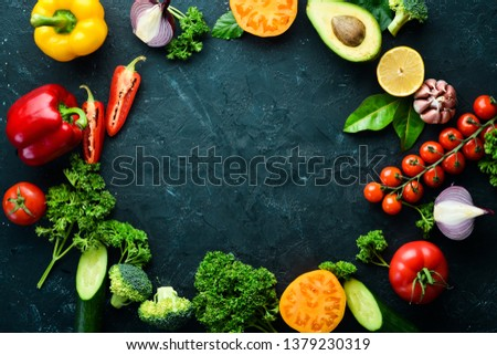 Fresh vegetables on a black background. Avocados, tomatoes, potatoes, paprika, citrus. Top view. Free space for your text. #1379230319