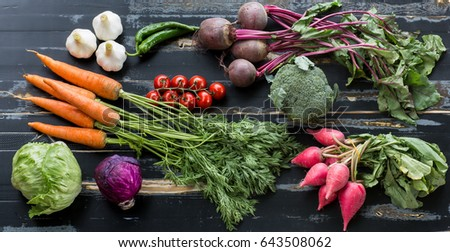Fresh vegetables on a rustic table #643508062