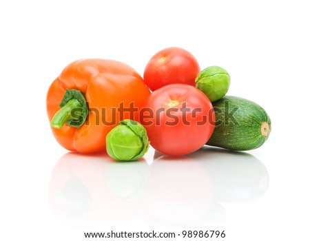 fresh vegetables on a white background with reflection closeup