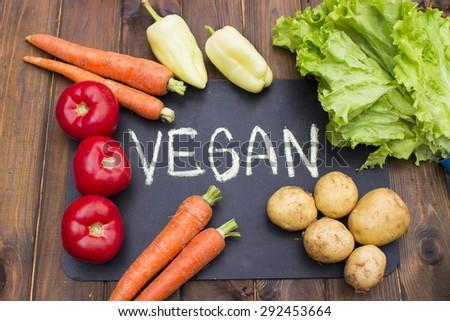 Fresh vegetables on a wooden background in garden #292453664